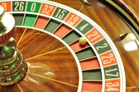image with a casino roulette wheel with the ball on number 21 photo