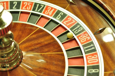 image with a casino roulette wheel with the ball on number 13 photo