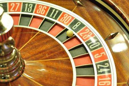 image with a casino roulette wheel with the ball on number 8 photo