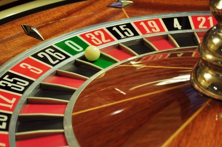 roulette wheels: image with a casino roulette wheel with the ball on number 0