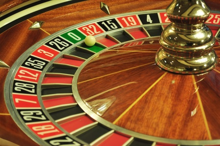 image with a casino roulette wheel with the ball on number 0 photo