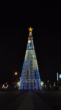 huge christmas tree: Huge Christmas tree in the drobeta turnu severin city centre shoot in the night Stock Photo