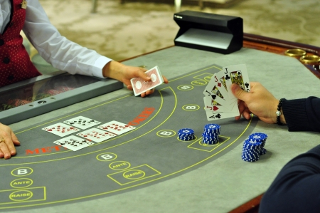 real casino poker table with player hand with four of a kind