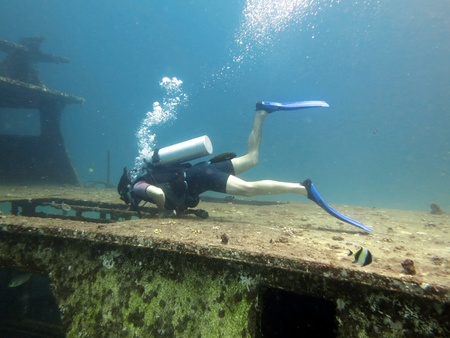 brac: Young Man Scuba Diver between Water Surface near a shipwreck