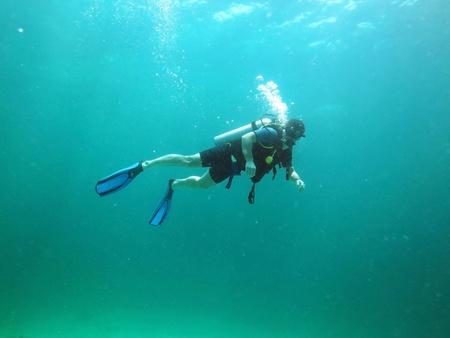 Young Man Scuba Diver between Water Surface photo