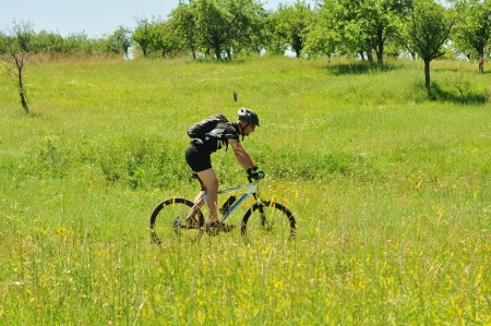 Cyclist on the Riding Bicycle Walk in Summer Nature outdoors photo