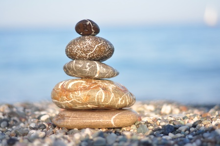 zen dark round stones on the beack good for wallpaper photo