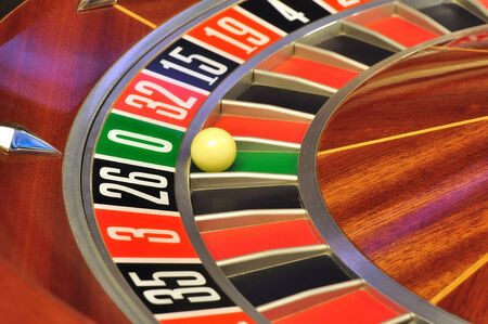 roulette wheel: image with a casino roulette wheel with the ball on number zero