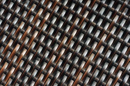 braiding: plastic ratan braiding texture diagonal pattern background Stock Photo