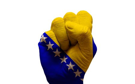 aggresive: man hand fist painted country flag of bosnia herzegovina