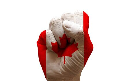 declaration: man hand fist painted alliance flag of canada Stock Photo