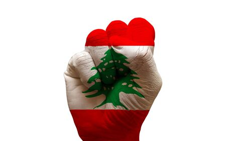 aggresive: man hand fist painted country flag of lebanon