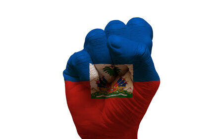 aggresive: man hand fist painted country flag of haiti
