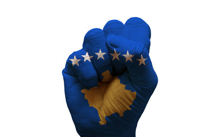 aggresive: man hand fist painted country flag of kosovo Stock Photo