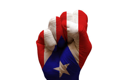 aggresive: man hand fist painted country flag of puerto rico Stock Photo
