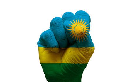 aggresive: man hand fist painted country flag of rwanda Stock Photo
