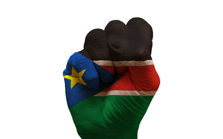 aggresive: man hand fist painted country flag of south sudan