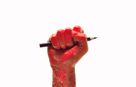 man hand raised fist with pencil freedom of speech symbol photo