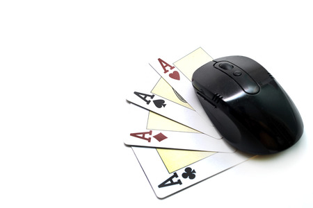 4 of a kind: computer mouse and four card aces isolated over white background Stock Photo