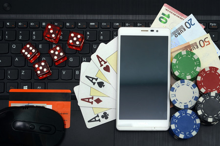 casino game: online casino games concept computer and smart phone