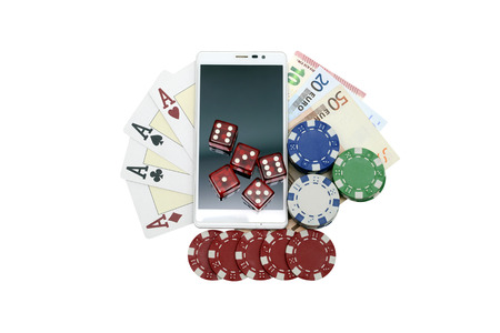 four of a kind: smartphone casino chips poker cards dice and money Stock Photo