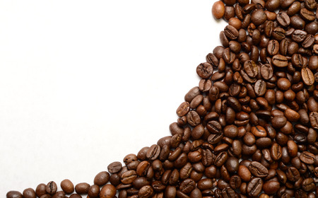 partially: Partially filled with roasted coffee beans background