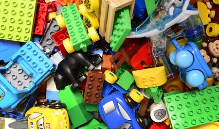 mess: various colorful toys box mess texture background Stock Photo