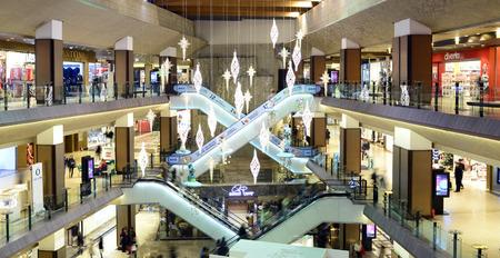 atrium: TIMISOARA, ROMANIA - 12.17.2015: city mall escalators interior design atrium architecture