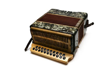 acordeón: vendimia instrumento de música de acordeón sobre el fondo blanco Foto de archivo