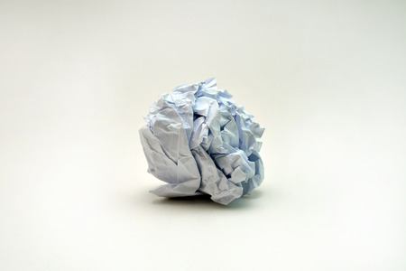 limp: writer without inspiration crumpled paper ball on white