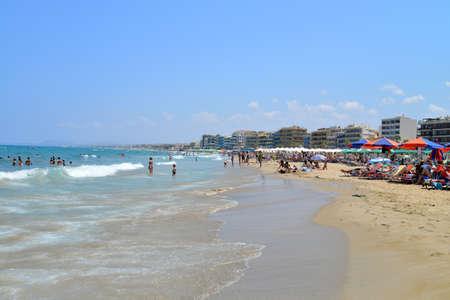 rethymno: RETHYMNO, GREECE - 08.03.2016: city beach with people editorial Editorial