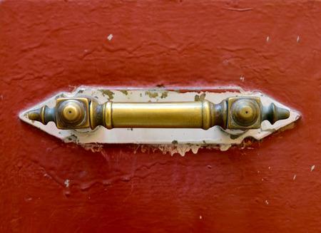 lug: old wood door metal handle close detail