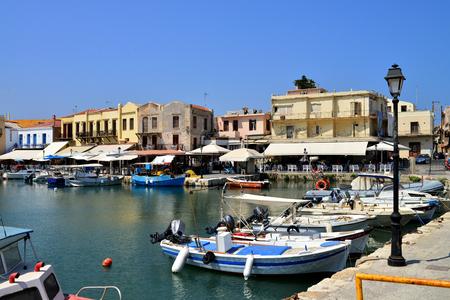 rethymno: RETHYMNO, GREECE - 08.03.2016: Crete Greece Venetian harbour boats and architecture Editorial