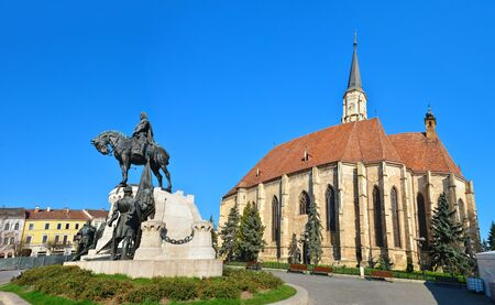 Cluj Napoca city Romania Statue of Matei Corvin and Saint Michaelâ??s Church Stock Photo