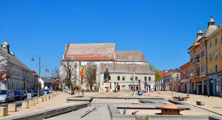 turda: TURDA, ROMANIA - 04.04.2017: Republic Square and Avram Iancu statue landmark architecture