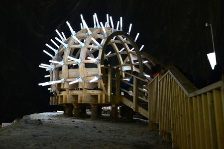 turda: TURDA, ROMANIA - 04.04.2017: salt mine wood and neon light pavilion Editorial