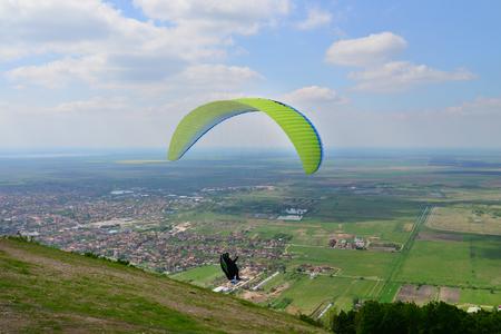 sportman: Paraglider sportman flies in the blue summer sky