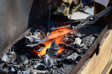 Blacksmith forge hot metal and fire detail