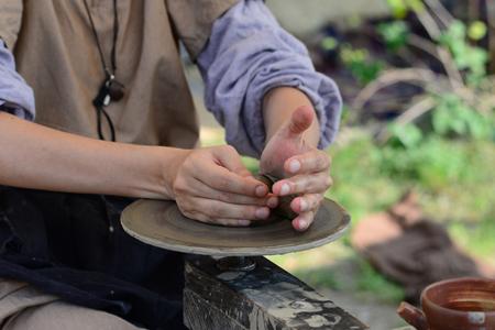 Medieval woman potter hands modeling ceramics close detail