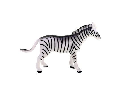 Plastic toy zebra isolated over white