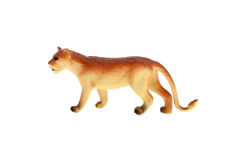 Plastic toy lioness isolated over white