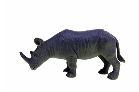 Plastic toy rhino isolated over white