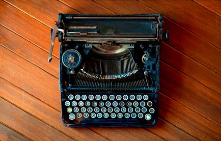 Old vintage typewriter on wood table bird view