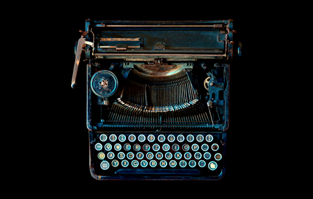 Old vintage typewriter isolated over black top view Banco de Imagens