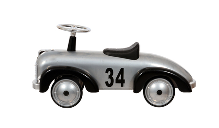 Vintage metal car toy isolated over white