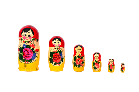 Matryoshka Russian dolls set in a row isolated over white
