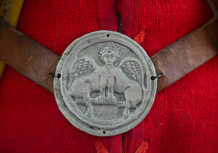 Roman empire soldier uniform griffin symbol medallion