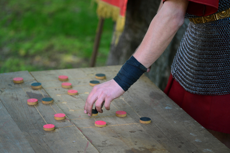 Roman soldier playing a board game named merellus or the mill
