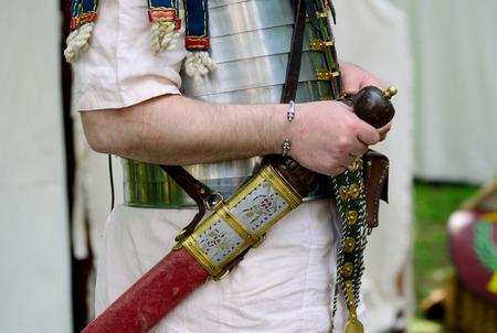 Roman empire soldier holding a Gladius sword detail