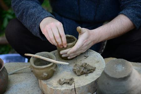 Ancient Dacian potter man making a clay bowl Banco de Imagens